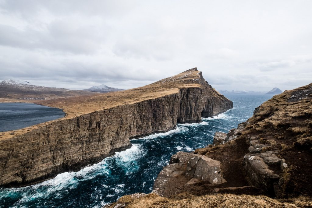 Leitisvatn above the rough ocean in Miðvágur (Faroe Islands)