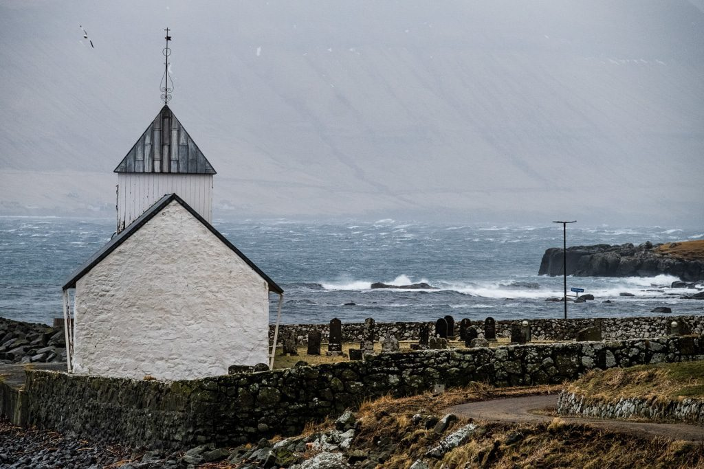 Church on the ocean in Kirkjubøur (Faroe Islands)